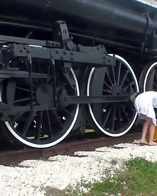 Hot MILF Fucks Herself With Dildo Next To Railroad Tracks