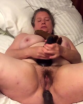BBW mom with hairy pussy takes BBC dildo with foreskin