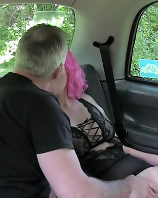 Pink haired hottie deep throats in fake taxi