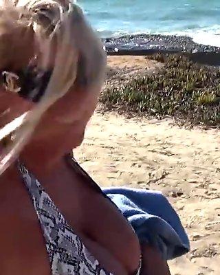 Big titty blonde MILF flashes in public