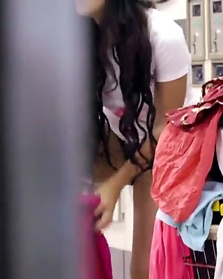 Sexy Latina changing in laundromat