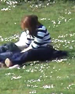 Couple in park handjob voyeur.