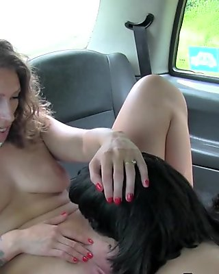 Blonde lesbo takes panties into cunt in fake taxi