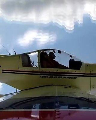 Big tits hottie masturbating on a plane