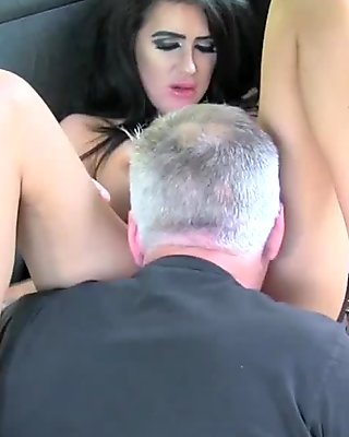 Dark haired babe passionately rimming in cab